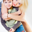 Stock Photo: Mamhugs her son