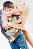 Mama hugs her son — Stock Photo