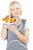Girl with a basket of fruit — Stock Photo