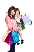 Girl with a child with shopping — Stockfoto