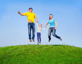 Happy family in the jump — Stock Photo