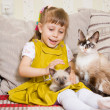 Stock Photo: Girl with a kitten