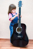 Little girl with a guitar — Stock Photo