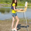 Girl drawing in the open air — Stock Photo