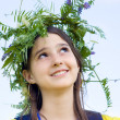 Girl wearing a crown of flowers — Stock Photo