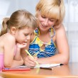 Mom with a child draws — Stock Photo #5908768
