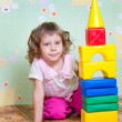 The girl has built a tower out of blocks — Stock Photo