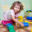 Stock Photo: The girl has built a tower out of blocks