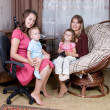 Two women with children — Stockfoto