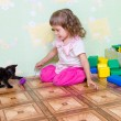 The girl plays with a kitten - Stok fotoğraf