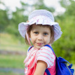 Girl standing with a backpack — Stock Photo