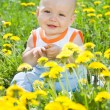 Baby children on the grass — Stock Photo #6025640