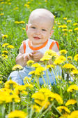 Baby children on the grass — Stock Photo