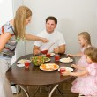 Stock Photo: Family gathers for dinner