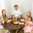 Family gathers for dinner — Stock Photo