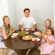 Royalty-Free Stock Photo: Family gathers for dinner