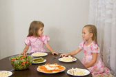 Two little girls at the table — Stock Photo