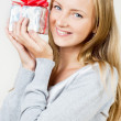 A girl with a gift — Stock Photo