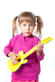A girl with a guitar — Stock Photo