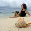 Relaxed young woman sits as background while the crab shell in focus as for — Stock Photo