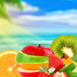 Fruit on a beach — Stock Photo #5864521