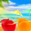 Fruit cocktail on a beach — Stock Photo #5864584