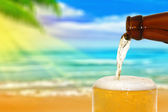 Beer on a beach — Stock Photo