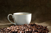 Coffee cup and grain — Stockfoto