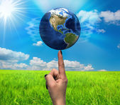 World on a finger — Stock Photo