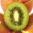 Kiwi fruit and oranges — Stock Photo
