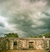 Stormy clouds over ancient building — Stock Photo