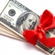 Dollars with red ribbon isolated on white — Stock Photo