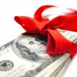 Dollars with red ribbon - Stock Photo