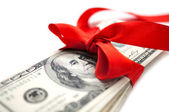 Dollars with red ribbon — Foto de Stock