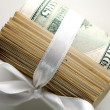 Dollar roll tightened with ribbon — Stock Photo