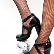 Dancers legs with disco ball — Stock Photo