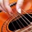 Closeup of a guitarist playing — Stock Photo