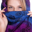 Blonde woman in shawl on white background — Stock Photo