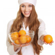 Healthy eating or lifestyle concept. woman doctor with many oran — Stock Photo