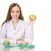 Healthy eating or lifestyle concept. woman doctor with a green a — Stock Photo