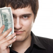Young handsome man holding dollars — Stock Photo #5538661