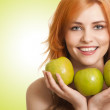 Young beauty woman with apple on green background — Stock Photo
