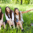 Three beautiful smile student girl in the park — Stock Photo