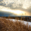 Sunset over snow field — Stock Photo