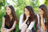 Three beautiful smile student girl in the park — Stockfoto