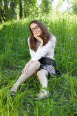 Beautiful student girl in the park — Stok fotoğraf