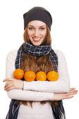 Happy woman with orange on white background — Stock Photo