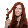 Beautiful woman curling long hair isolated — Stock Photo #5683753