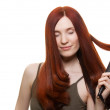 Beautiful woman curling long hair isolated - Stock Photo