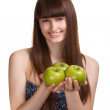 Young happy smiling woman with green apple isolated on white - Stock Photo